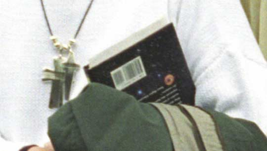 Close up of the book in Hillary Clinton's arm.  Click the image to go to a book cover comparrison.