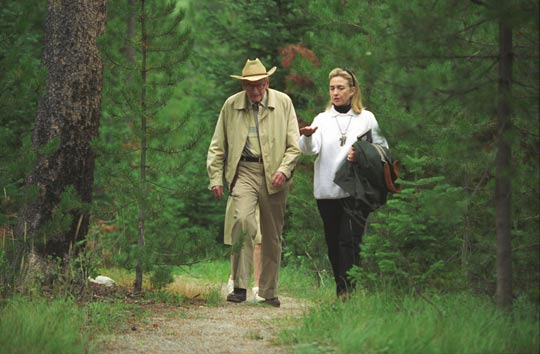 Hillary Clinton and Laurance Rockefeller walking at his Wyoming Ranch (image credit: Clinton Library)