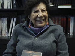 The 84-year old author Guadalupe Rivera holding her book.