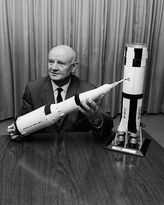 The notorious Arthur Rudolph with a model of the Saturn V.