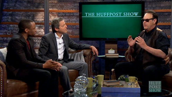 Dan Aykroyd talks about UFOs and cover-ups on The Huffington Post's The HuffPost Show. A bottle of his Crystal Head Vodka can be seen on the coffee table. (Credit: The Huffington Post)