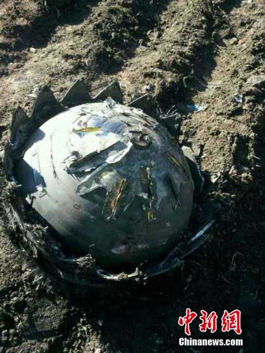 Closer image of the strange object that crashed into a man's vegetable garden in Heilongjiang, China. (Credit: Chinanews.com)