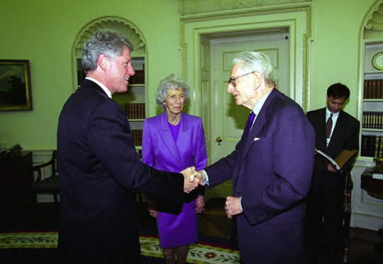 Bill Clinton shaking hands with Laurance Rockefeller (image credit: Clinton Library)