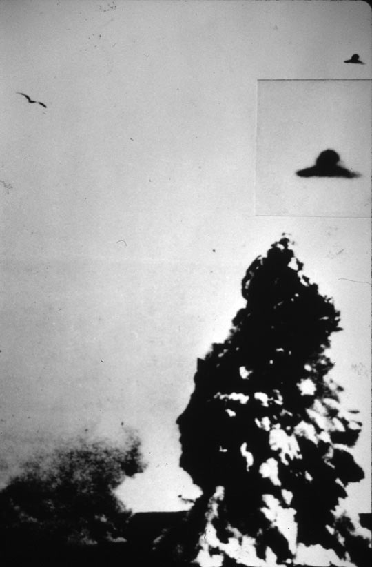 Flying disc next to an underwater volcanic eruption reportedly taken on Dec. 11, 1967 by a Navy officer at the Antarctic Station in Deception Is., leaked to the weekly magazine Siete Días. The disc on the top is the real size of the object; the second an enlargement. (image credit: ICUFON Archives)