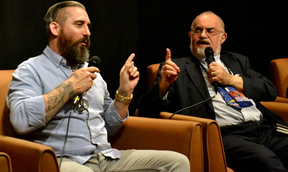 Jeremy Corbell (left) debating Bob Lazar with Stanton Friedman at the 2015 International UFO Congress. Click the image to see the debate. (Credit: Carlo Petrick)