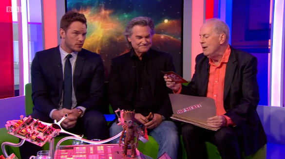 Guardians of the Galaxy actors Chris Pratt and Kurt Russell listen to The One Show host Gyles Brandreth tell a UFO story. (Credit: The One Show)