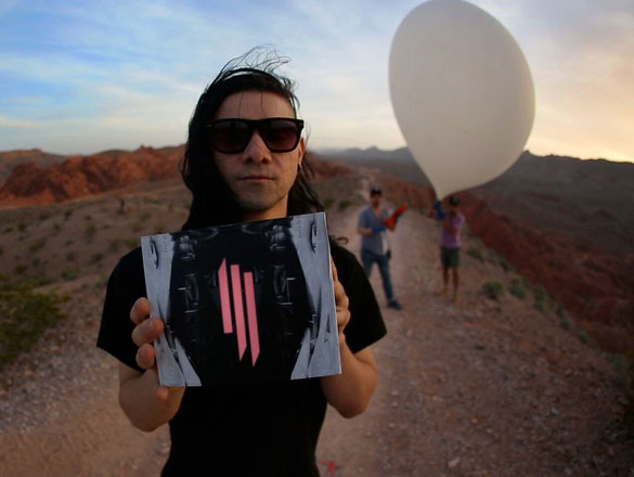 Promotional image of Skrillex with artwork that appears on one version of the phone cases. A baloon can be seen in the background, similar to the baloons used to capture satelite imagery. (Credit: PSFK)