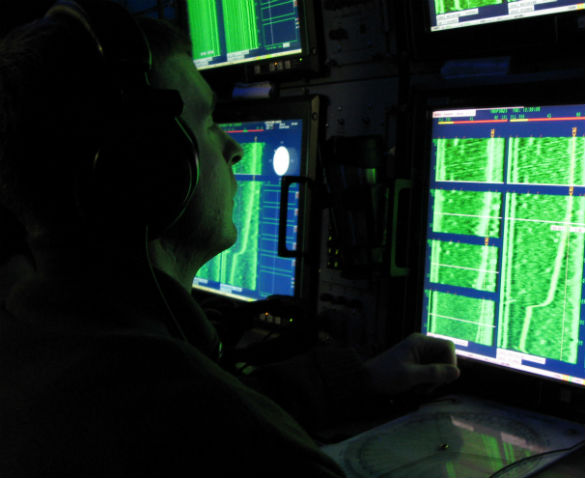 Navy Petty Officer 2nd Class Shawn Halliwell checks his sonar system during a battle drill aboard the strategic missile submarine USS Maryland, Feb. 16, 2009. (Credit: US Department of Defense/Gerry J. Gilmore)