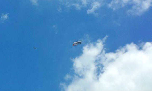 Image of an airplane pulling an advertisement banner.