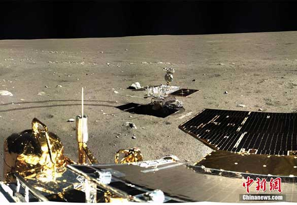"""China's Yutu (""""Jade Rabbit"""") rover on the Moon's Mare Imbrium, as pictured by the Chang'e-3 lunar lander, seen in the foreground. (Credit: CNS)"""