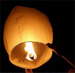 A Chinese lantern being launched (credit: wishlantern.com)