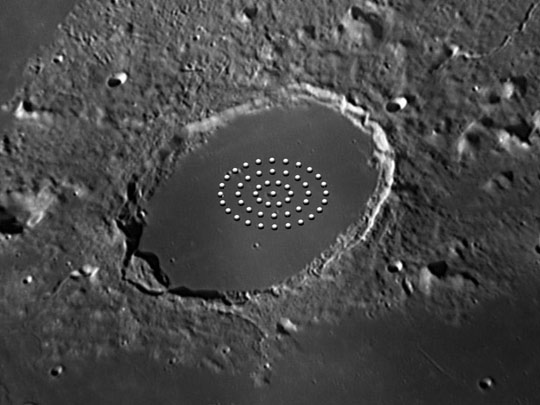 Illustration of bright dots seen on the moon crater Plato in 1877.