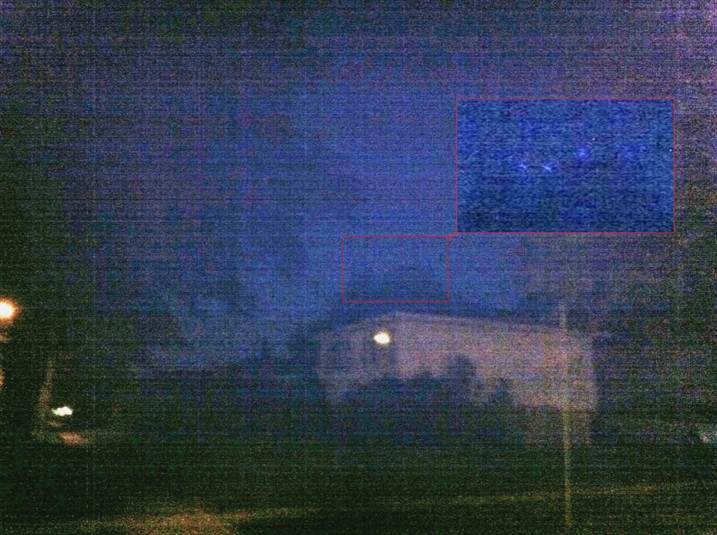 This photo was provided by the witness who stopped and used a cell phone to try and capture the large, V-shaped UFO. (Credit: MUFON)
