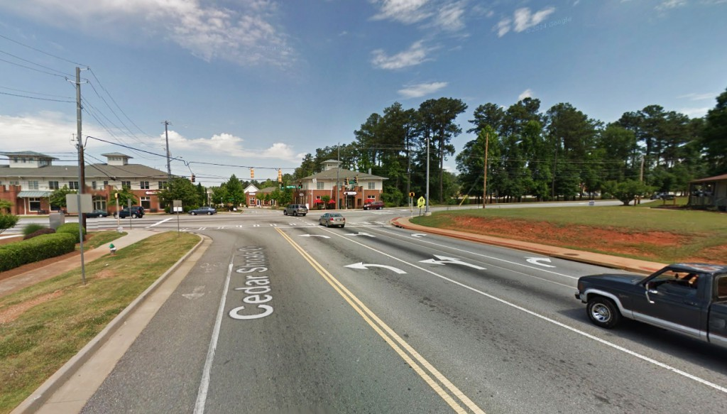The Athens, GA, witness was driving northwest along Cedar Shoals Drive and stopped at a red light at the intersection of Barnett Shoals Road and Gaines School Road, pictured, when the triangle-shaped UFO was seen about 200 feet above the intersection. (Credit: Google)