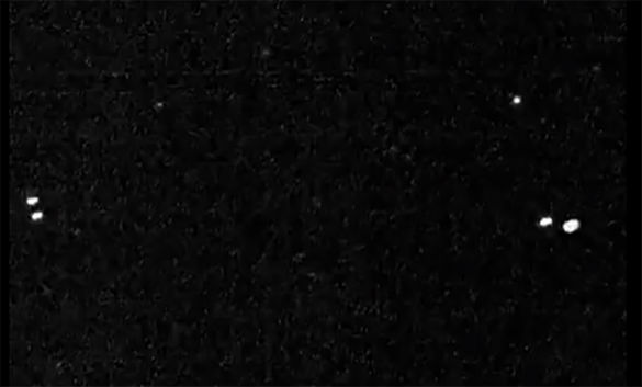 Image from witness video allegedly showing a UFO on left and military aircraft on right. (Credit: MUFON)