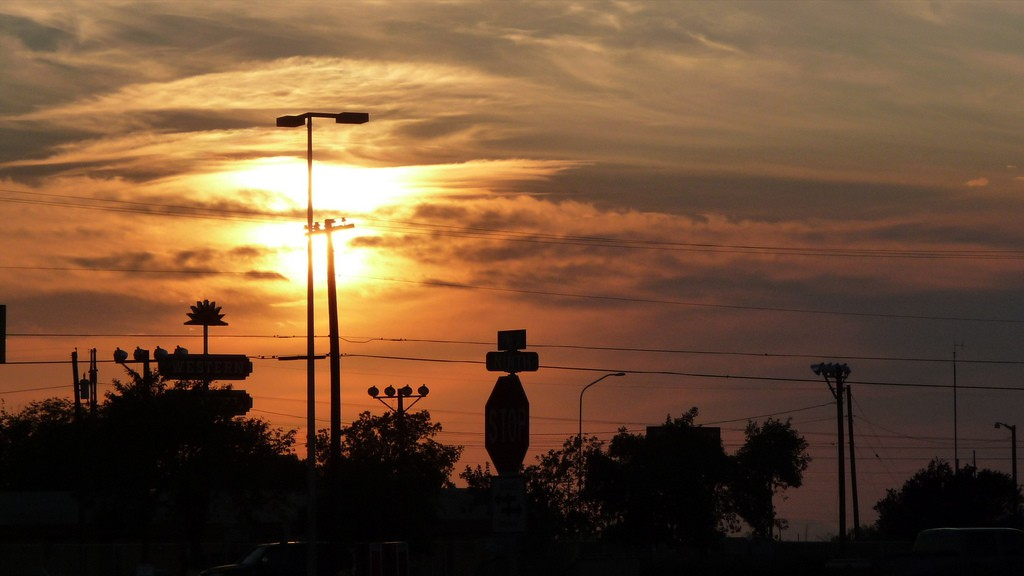 The witness and a passenger ruled out known objects and believe they saw a UFO. Pictured: Sunset at the Sonic Drive-In, Deming. (Credit: Wikimedia Commons)
