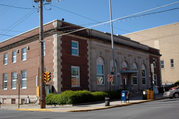 The object's size hovering over a neighbor's rooftop was described as the size of an above ground swimming pool. Pictured: Lewistown, PA, Post Office (Credit: Wikimedia Commons)