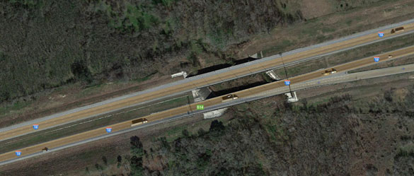 The trucker felt the intense heat as he drove under the objects. Pictured: The mile marker 614 area. (Credit: Google Maps)