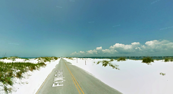 The witness watched the object land back at the air base. Pictured: Perdido Key, Florida, near the Pensacola Naval Air Station. (Credit: Google)