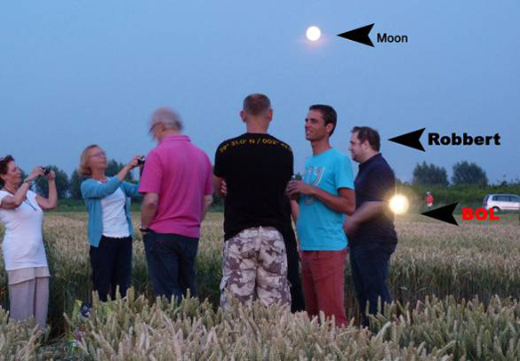 """Brilliant yellow light-ball (""""BOL""""), not seen by photographer, appears in photo of Robbert  & visitors to this July 21st formation.  Photo: Jeanne Stolzenbach."""