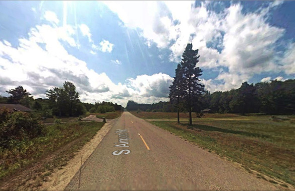 The Michigan witness near Newberry stopped his dirt bike along South Airport Road, pictured, to look at a silent object hovering over a nearby potato field. (Credit: Google)