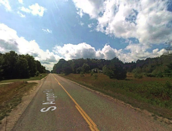 The witness first saw the disc-shaped object while driving his dirt bike home from work along South Airport Road, pictured, when he panicked and began heading home. The object followed. (Credit: Google)