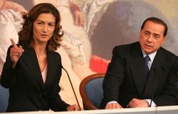 Left: Mariastella Gelmini, Italian Minister of Education Right: Silvio Berlusconi, Italian Prime Minister