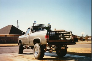 A truck with two spotlights.